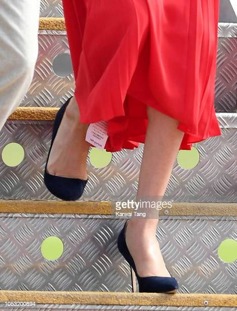 FUA'AMOTU TONGA OCTOBER 25 Meghan Duchess of Sussex dress detail arrives at Fua'amotu Airport on October 25 2018 in Nuku'alofa Tonga The Duke and...