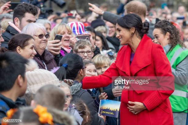 Meghan Duchess of Sussex greet wellwishers on Hamilton Square as they visit a new statue to mark the 100th anniversary of the death of poet Wilfred...