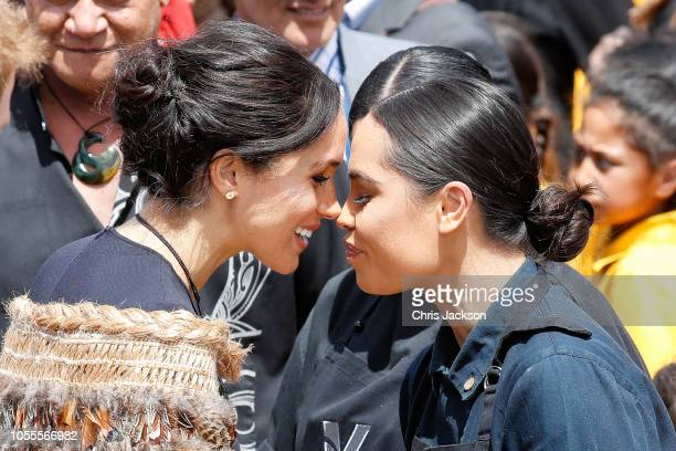 Meghan Duchess of Sussex greeting locals in a traditional 'hongi' at the formal pØwhiri and luncheon held at Te Papaiouru Marae on October 31 2018 in...