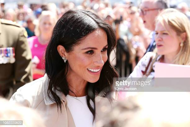 Meghan Duchess of Sussex greets members of the crowd at the Sydney Opera House on October 16 2018 in Sydney Australia The Duke and Duchess of Sussex...