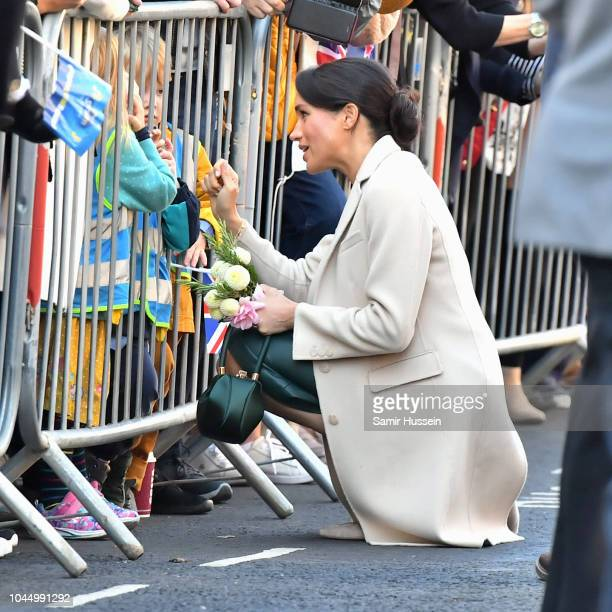 Meghan Duchess of Sussex greets members of the public as she arrives at Edes House in Chichester during an official visit to Sussex on October 3 2018...