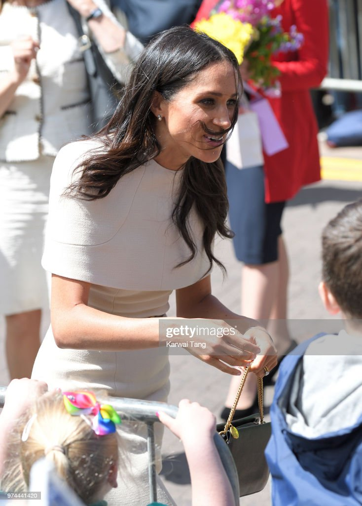 Meghan, Duchess of Sussex greets the crowd as she arrives at Chester Town Hall, where the Duchess and Queen Elizabeth II will attend lunch as guests of Chester City Council on June 14, 2018 in Chester, England. Meghan Markle married Prince Harry last month to become The Duchess of Sussex and this is her first engagement with the Queen. During the visit the pair opened a road bridge in Widnes and visited The Storyhouse in Chester.