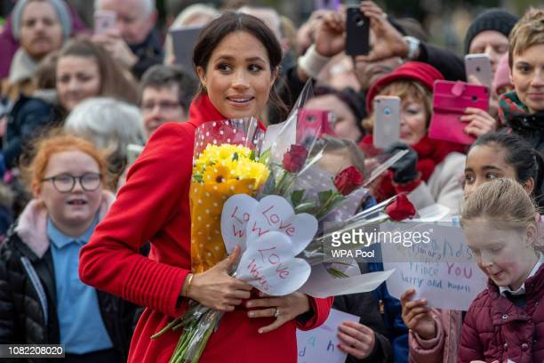 Meghan Duchess of Sussex greets well wishers as she visits a statue to mark the 100th anniversary of the death of poet Wilfred Owen which was erected...