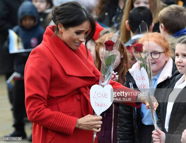 Meghan Duchess of Sussex greets wellwishers as she visits Birkenhead northwest England on January 14 2019