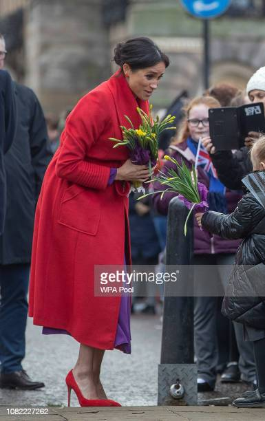 Meghan Duchess of Sussex greets wellwishers on Hamilton Square as she visits a new statue to mark the 100th anniversary of the death of poet Wilfred...