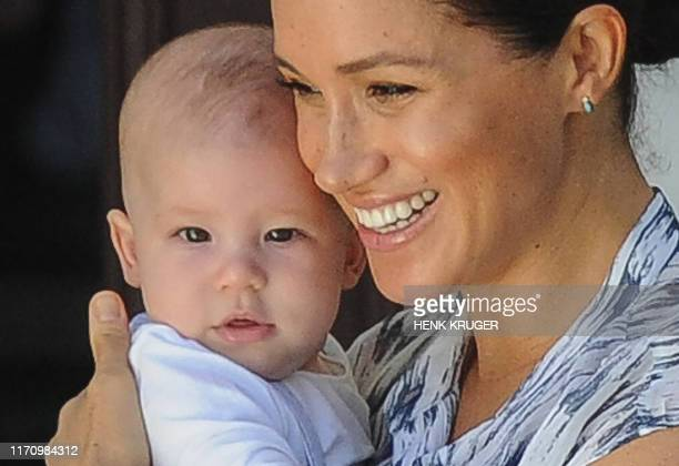 Meghan, Duchess of Sussex holds her baby son Archie as she and Britain's Prince Harry, Duke of Sussex meet Archbishop Desmond Tutu and his wife Leah...