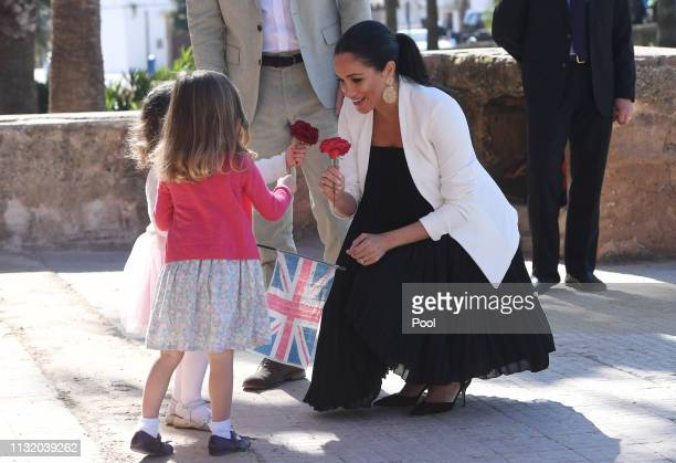 Meghan Duchess of Sussex is greeted by young wellwishers as she and Prince Harry Duke of Sussex walk through the walled public Andalusian Gardens...