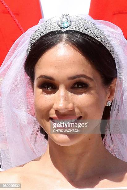 Meghan Duchess of Sussex is seen in the Ascot Landau Carriage during the procession outside St George's Chapel Windsor Castle in Windsor on May 19...
