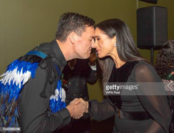 Meghan Duchess of Sussex is welcomed with a traditional Maori greeting of rubbing noses known as a 'hongi' as she opens 'Oceania' at Royal Academy of...