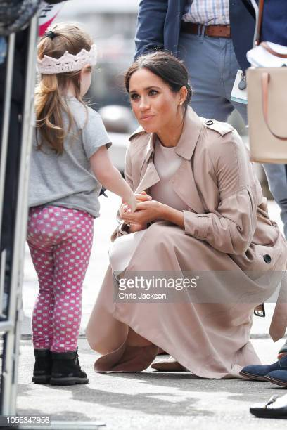 Meghan, Duchess of Sussex kneeling down to talk to a young girl during 'Walkabout' on October 30, 2018 in Auckland, New Zealand. The Duke and Duchess...