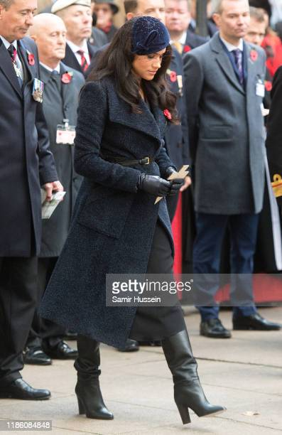 Meghan, Duchess of Sussex lays a cross carrying a personal message in memory of those who lost their lives in the service of others as she attends...
