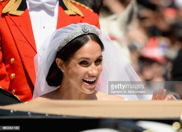 Meghan Duchess of Sussex leaves Windsor Castle in the Ascot Landau carriage during a procession after getting married at St Georges Chapel on May 19...