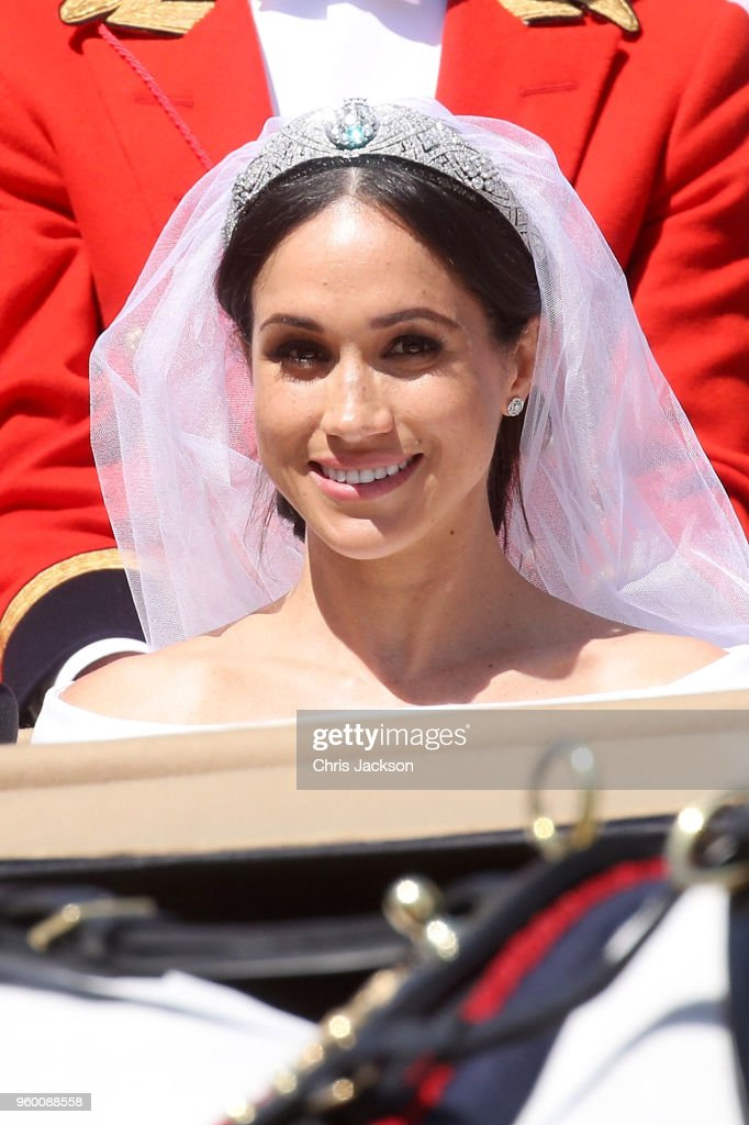 Meghan, Duchess of Sussex leaves Windsor Castle in the Ascot Landau carriage during a procession after getting married at St Georges Chapel on May 19, 2018 in Windsor, England. Prince Henry Charles Albert David of Wales marries Ms. Meghan Markle in a service at St George's Chapel inside the grounds of Windsor Castle. Among the guests were 2200 members of the public, the royal family and Ms. Markle's Mother Doria Ragland.