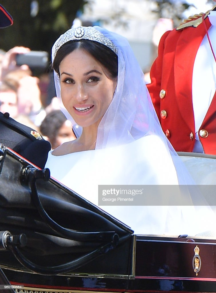 Meghan, Duchess of Sussex leaves Windsor Castle in the Ascot Landau carriage during a procession after getting married at St Georges Chapel on May 19, 2018 in Windsor, England. Prince Henry Charles Albert David of Wales marries Ms. Meghan Markle in a service at St George's Chapel inside the grounds of Windsor Castle. Among the guests were 2200 members of the public, the royal family and Ms. Markle's mother, Doria Ragland