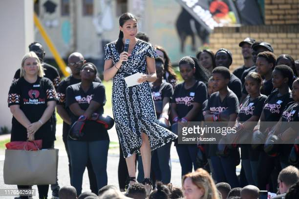 Meghan, Duchess of Sussex makes a speech as she visits a Justice Desk initiative in Nyanga township with Prince Harry, Duke of Sussex, during their...
