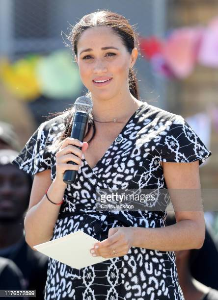 Meghan, Duchess of Sussex makes a speech as she visits a Justice Desk initiative in Nyanga township, with Prince Harry, Duke of Sussex, during their...