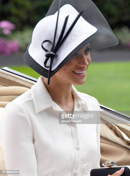 Meghan Duchess of Sussex making her Royal Ascot debut arrives in an open carriage to attend the first day of Royal Ascot on June 19 2018 in Ascot...