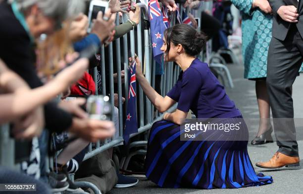 Meghan Duchess of Sussex meet a young fan at the public walkabout at the Rotorua Government Gardens on October 31 2018 in Rotorua New Zealand The...