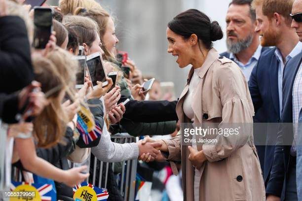 Meghan Duchess of Sussex meeting fans and holding baby bump on the street during 'Walkabout' on October 30 2018 in Auckland New Zealand The Duke and...