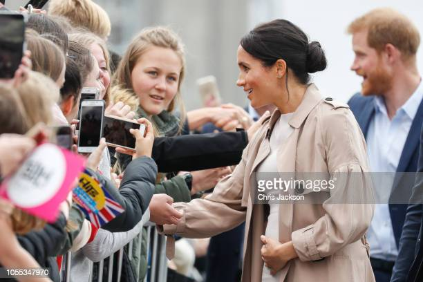 Meghan, Duchess of Sussex meeting fans and holding baby bump on the street during 'Walkabout' on October 30, 2018 in Auckland, New Zealand. The Duke...