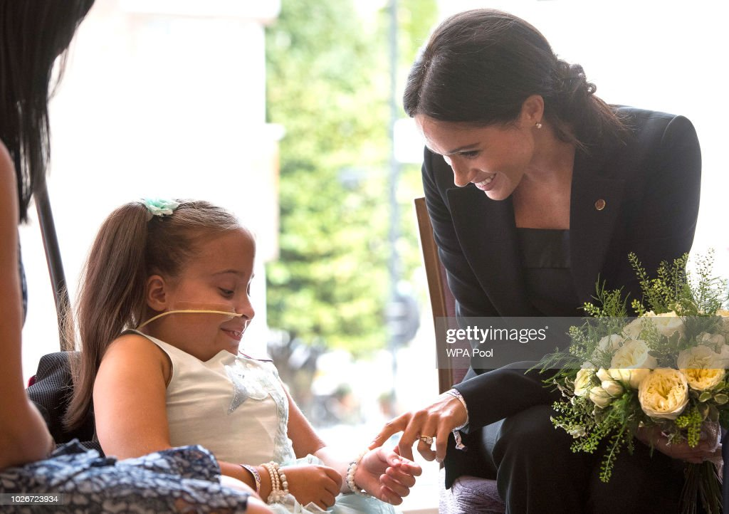 Meghan, Duchess of Sussex meets 7 year old Matilda Booth during the annual WellChild awards at Royal Lancaster Hotel on September 4, 2018 in London, England. The Duke of Sussex has been patron of WellChild since 2007.