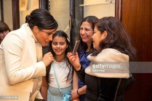 Meghan Duchess of Sussex meets children form Urbanwise as she attends a gala performance of 'The Wider Earth' in support of the Queen's Commonwealth...