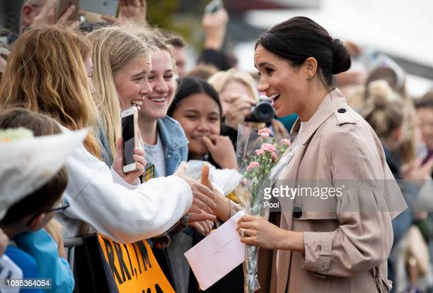 Meghan Duchess of Sussex meets fans during a public walk along Auckland's Viaduct Harbour on October 30 2018 in Auckland New Zealand The Duke and...