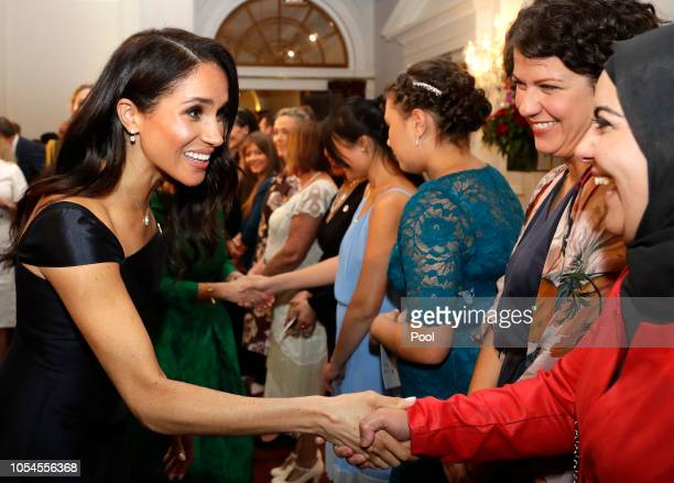Meghan Duchess of Sussex meets guests at a reception hosted by the GovernorGeneral celebrating the 125th anniversary of women's suffrage in New...