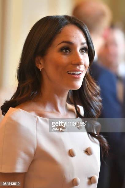 Meghan Duchess of Sussex meets guests at the Queen's Young Leaders Awards Ceremony at Buckingham Palace on June 26 2018 in London England The Queen's...
