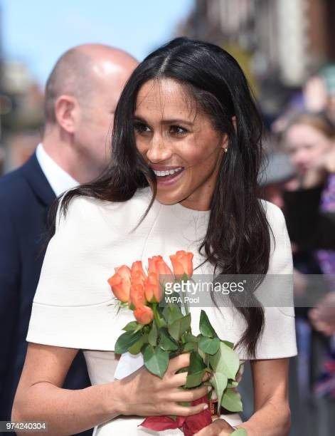 Meghan Duchess of Sussex meets members of public as she and Queen Elizabeth II walk from Storyhouse to Chester Town Hall on June 14 2018 in Chester...