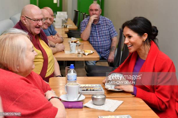 Meghan Duchess of Sussex meets with local residents as she officially opens 'Number 7' a 'Feeding Birkenhead' citizens' supermarket and community...