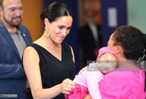 Meghan, Duchess of Sussex meets with with 7 weeks old Sumeya as she visits mothers2mothers during her royal tour of South Africa with Prince Harry,...