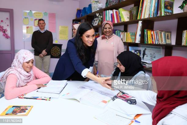 Meghan Duchess of Sussex meets young girls as she visits the Education For All boarding house for girls aged 12 to 18 with Prince Harry Duke of...