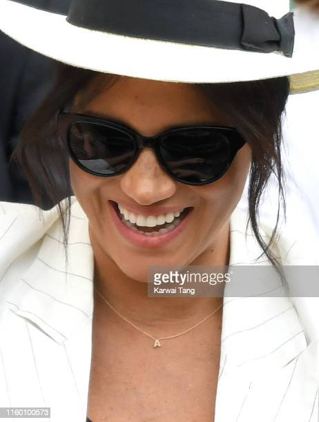 Meghan, Duchess of Sussex, necklace detail, attends day four of the Wimbledon Tennis Championships at All England Lawn Tennis and Croquet Club on...
