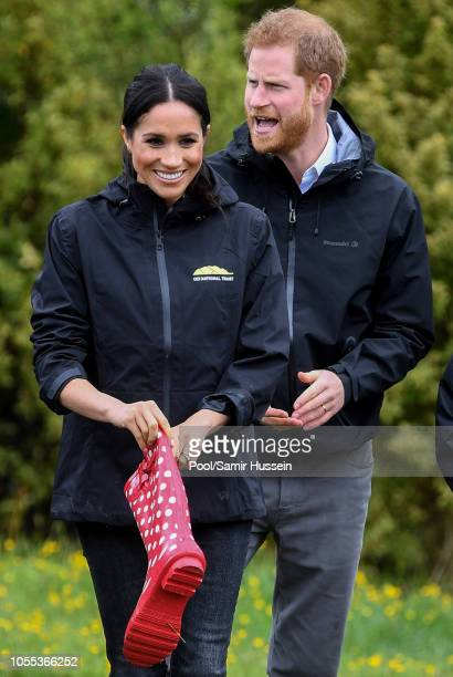 Meghan, Duchess of Sussex participates in wellie wanging with Prince Harry, Duke of Sussex as they visit the North Shore to dedicate a 20-hectare...