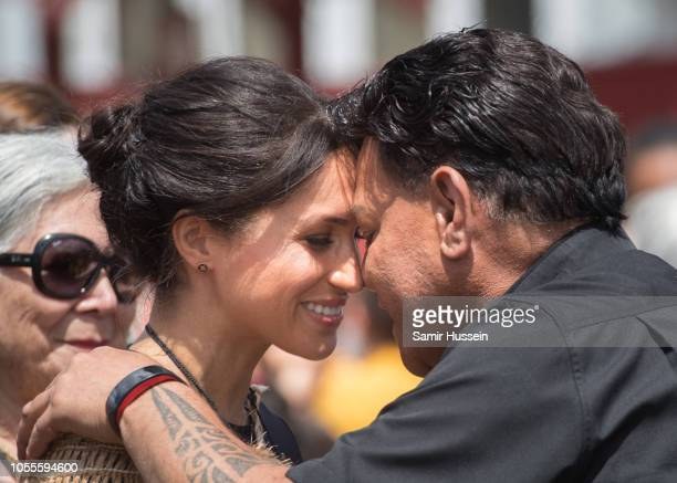 Meghan Duchess of Sussex performs a hongi as he visits Te Papaiouru Marae for a formal powhiri and luncheon on October 31 2018 in Rotorua New Zealand...