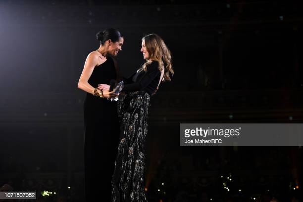 Meghan, Duchess of Sussex presents the award for British Designer of the Year Womenswear Award to Clare Waight Keller for Givenchy during The Fashion...