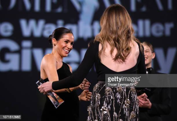 Meghan Duchess of Sussex presents the award for British Designer of the Year Womenswear Award to Clare Waight Keller for Givenchy during The Fashion...