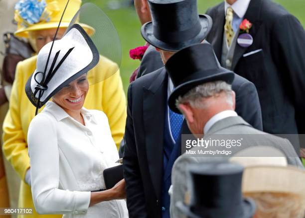 Meghan Duchess of Sussex Prince Charles Prince of Wales and Prince Harry attend day 1 of Royal Ascot at Ascot Racecourse on June 19 2018 in Ascot...