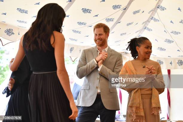 Meghan Duchess of Sussex Prince Harry Duke of Sussex and Doria Ragland attend an event to mark the launch of a cookbook with recipes from a group of...