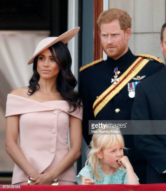Meghan, Duchess of Sussex, Prince Harry, Duke of Sussex and Isla Phillips stand on the balcony of Buckingham Palace during Trooping The Colour 2018...