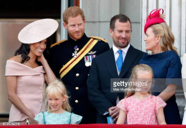 Meghan Duchess of Sussex Prince Harry Duke of Sussex Isla Phillips Peter Phillips Savannah Phillips and Autumn Phillips stand on the balcony of...