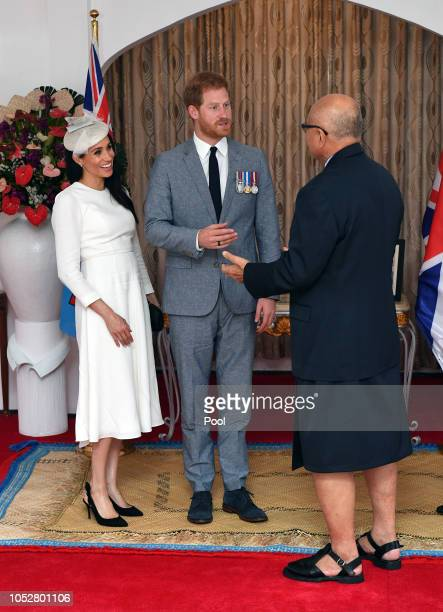 Meghan Duchess of Sussex Prince Harry Duke of Sussex meet President of Fiji Jioji Konrote on the first day off their tour to Fiji on October 23 2018...