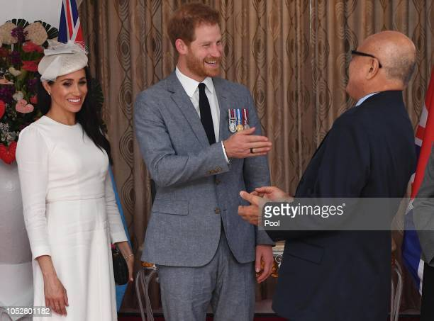 Meghan Duchess of Sussex Prince Harry Duke of Sussex meet President of Fiji Jioji Konrote on the first day of their tour to Fiji on October 23 2018...