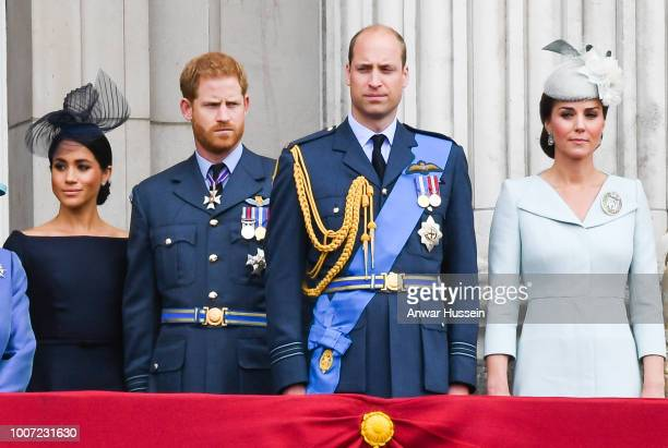 Meghan, Duchess of Sussex, Prince Harry, Duke of Sussex, Prince William, Duke of Cambridge and Catherine, Duchess of Cambridge stand on the balcony...