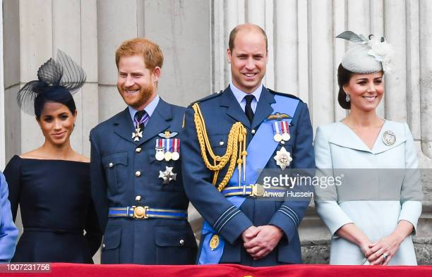 Meghan Duchess of Sussex Prince Harry Duke of Sussex Prince William Duke of Cambridge and Catherine Duchess of Cambridge stand on the balcony of...