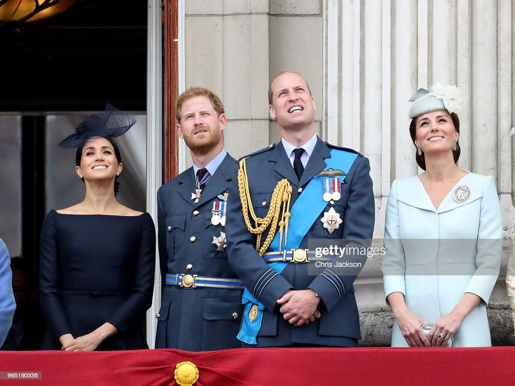 Meghan, Duchess of Sussex, Prince Harry, Duke of Sussex, Prince William, Duke of Cambridge and Catherine, Duchess of Cambridge watch the RAF flypast on the balcony of Buckingham Palace, as members of the Royal Family attend events to mark the centenary of the RAF on July 10, 2018 in London, England.