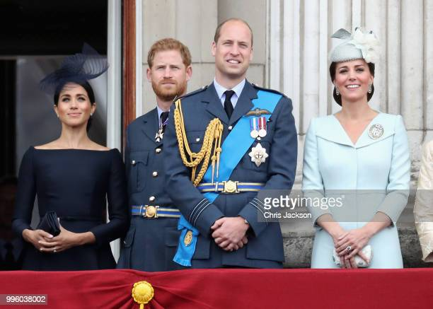 Meghan Duchess of Sussex Prince Harry Duke of Sussex Prince William Duke of Cambridge and Catherine Duchess of Cambridge watch the RAF flypast on the...
