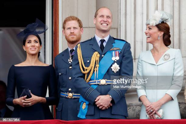 Meghan, Duchess of Sussex, Prince Harry, Duke of Sussex, Prince William, Duke of Cambridge and Catherine, Duchess of Cambridge watch a flypast to...