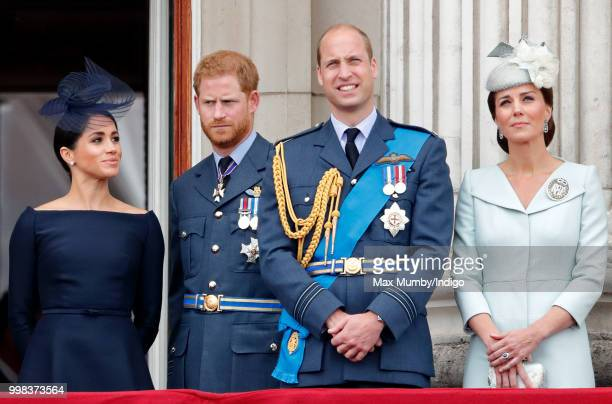 Meghan Duchess of Sussex Prince Harry Duke of Sussex Prince William Duke of Cambridge and Catherine Duchess of Cambridge watch a flypast to mark the...